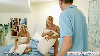 Busty wives Nikki Benz and Tasha Reign share cock in threesome
