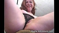 Busty Ginger masturbates her pussy with dildo