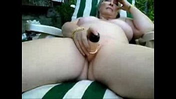 Pervert nude granny masturbates outdoor. Amateur older