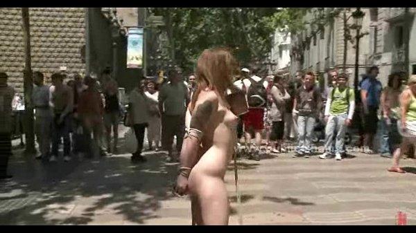 Brunette in outdoor public humiliation
