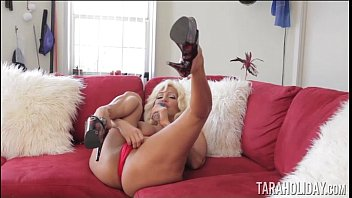 Horny Tara red masturbating on couch