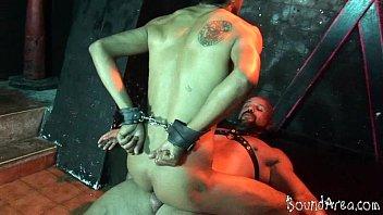 Young handcuffed sub rides a boner for a facial