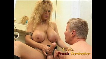 Latex-clad busty wench fucks a horny stud with a strap-on
