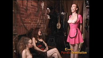 Two latex-clad harlots spank a ginger bitch before having some fun themselves
