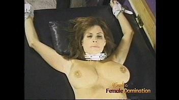 Charming brunette bimbo with big naturals gets whipped by two hot dominas
