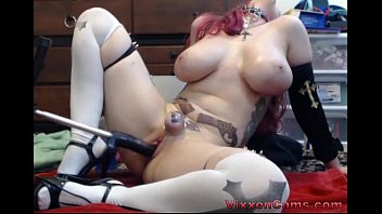 Busty redhead cam girl and her sex machine