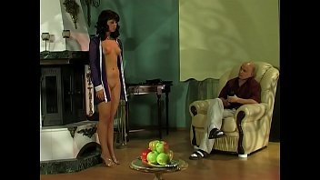 Cruel master plays with his submissive slave girl.
