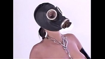 Mavellous chick in gas mask and her girlfriend are doing disabled person's dick