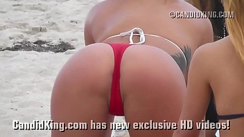 Sexy teen on the beach showing tan thong covered ass in public! 3 min