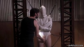 Slave in strait jacket and mask in bondage