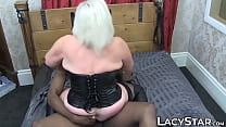 GILF in leather corset takes on two massive cocks 10 min