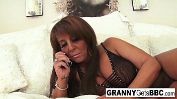 Busty brunette mature takes the black cock in her bed 7 min