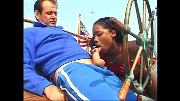 Pretty ebony model takes boss's dick inside her cunt on the yacht