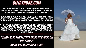Sindy Rose the fisting bride in public on the dunes 76 sec