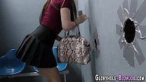 Brunette teenager at gloryhole gobbles
