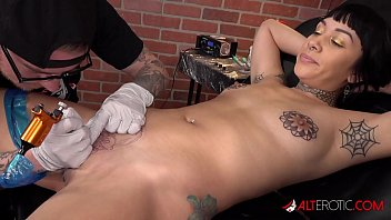 Selena Savage gets a pussy tattoo then sucks two dicks