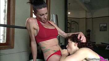TS trainer gets blowjob from redhead