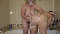 Mature lesbians in the bathroom. A chubby milf with big tits washes a fat girlfriend with a juicy PAWG. Homemade fetish.
