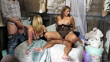 Busty blondes in sexy lingerie enjoying hardcore sex in foursome orgy