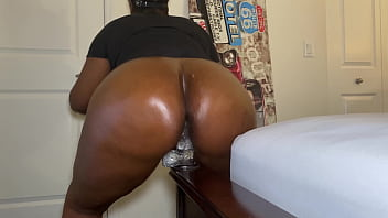Big Oiled Ebony Ass Riding Dildo 6 min