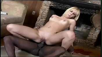 Sexy blond bitch has interracial sex with black stud in front of fireplace