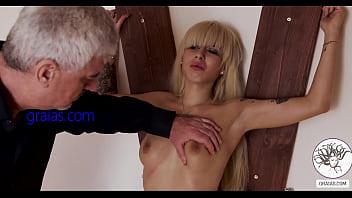Blonde barbie on the cross