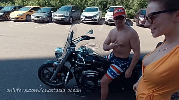 Naked girl on a motorcycle. Topless in the city. Emerald Ocean / Anastasia Ocean showing boobs outside