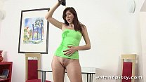 Kattie Gold toys her piss soaked pussy with green dildo